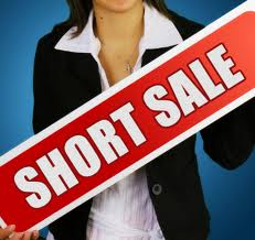 girl-holding-short-sale-sign - from Chris Curry